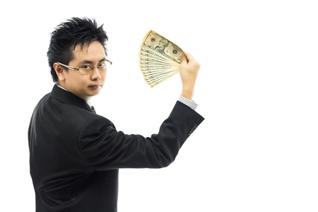 Businessman holding money isolated over white background photo