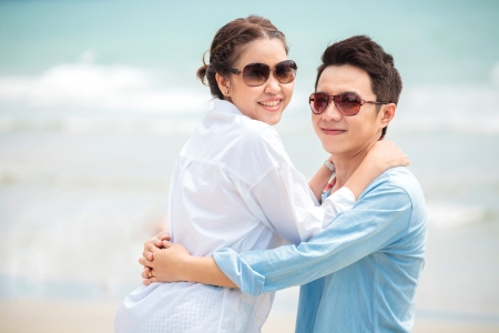 emotion faces: Happy Young Adult Couples in love outdoor at beach Stock Photo