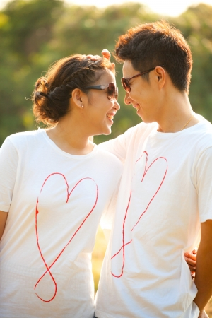 Happy Young Adult Couples in love outdoor Stock Photo