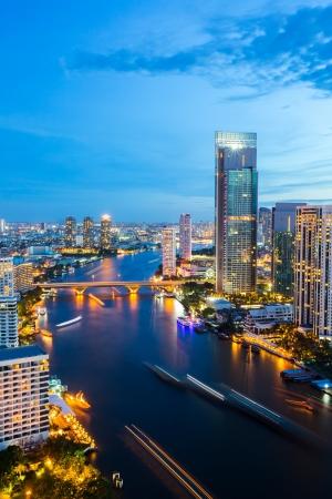 urbanscape: Aerial view of Bangkok Skyline along Chaophraya River sunset twilight