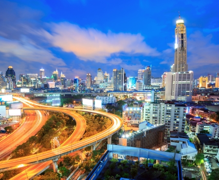Bangkok Highway at Dusk with skyline in Thailand photo