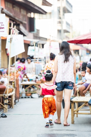 yom: SUKHOTHAI, THAILAND - MAY 4 : Unidentified tourists are shopping at Rim Yom 2437  market on May 4, 2013 in Sukhothai, Thailand.