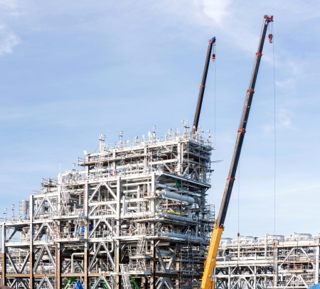 containment: Assembling of liquefied natural gas Refinery Factory with LNG storage tank using for Oil and gas industry background Editorial