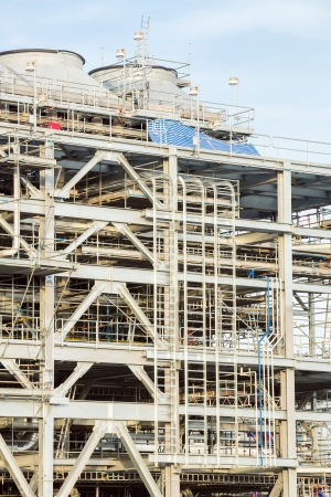 liquefied: Assembling of liquefied natural gas Refinery Factory with LNG storage tank using for Oil and gas industry background Editorial