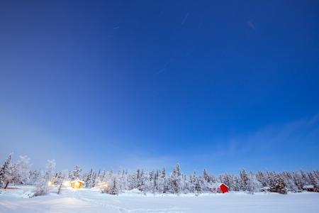 kiruna: Star Trail Winter landscape with cabin hut at night in Kiruna Sweden at Night