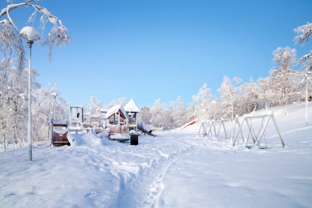 Winter Landscape of Kiruna Garden and playground Lapland Sweden photo