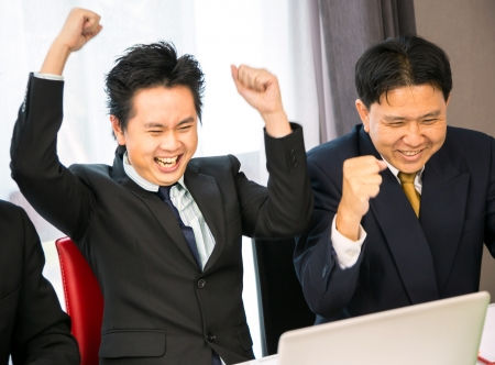 Businessmen celebrate their business success photo
