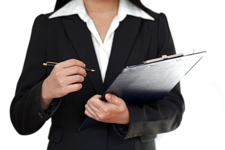 examiner: Businesswoman with clipboard and pen Stock Photo