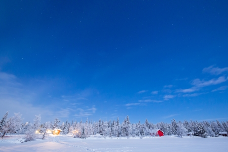 Star Trail Winter landscape with cabin hut at night in Kiruna Sweden at Night photo