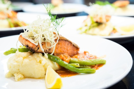 roquette: gourmet Grilled Salmon Steak with baked potato and lemon meal