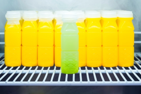 Guava juice against Orange juice bottles in refrigerator, leadership concept Stock Photo - 22419910