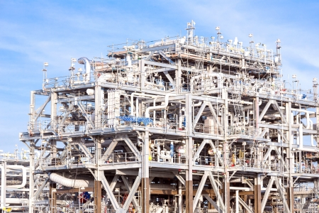 refineries: Assembling of liquefied natural gas Refinery Factory with LNG storage tank using for Oil and gas industry background Stock Photo