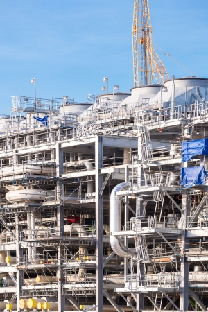 liquefied: Assembling of liquefied natural gas Refinery Factory with LNG storage tank using for Oil and gas industry background Stock Photo