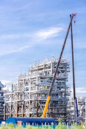 Assembling of liquefied natural gas Refinery Factory with LNG storage tank using for Oil and gas industry background Stock Photo - 22420034