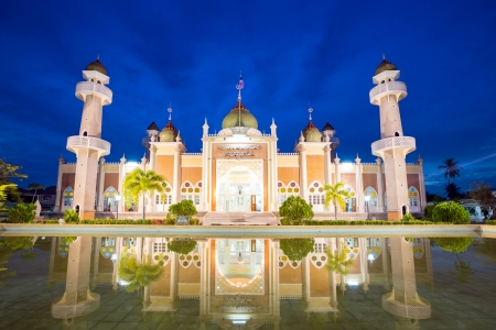 islamic scenery: Twilight view of central mosque with reflection in pond, Pattani, Thailand Stock Photo