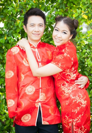 Happy Young Couple with chinese dress in love photo