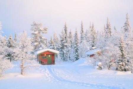 lapland: Sunrise Winter landscape with house at Kiruna Sweden lapland