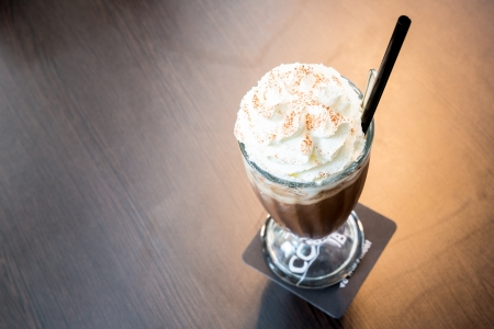 Cup of iced mocha coffee with whipping cream photo