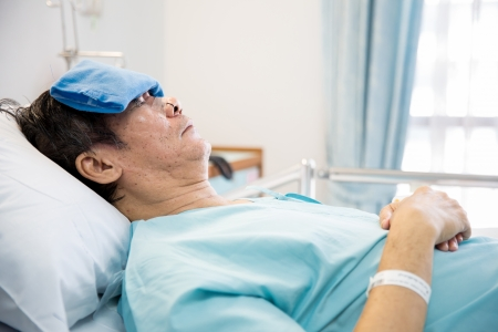 mature senior man Patient sleeping in hospital bed
