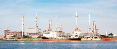 panorama landscape of Oil refinery plant along river with tanker photo