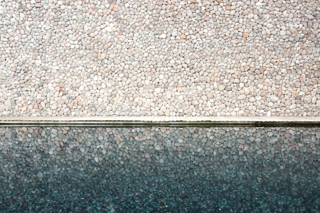 glass brick: Brick wall with wooden pavement and reflection from pool Stock Photo