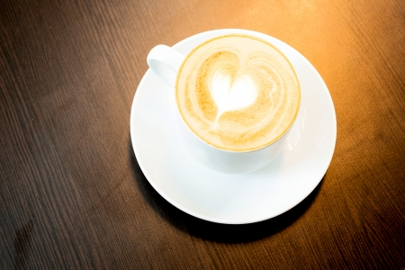 latte art: Cup of latte coffee with heart symbol Stock Photo