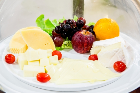 Variety of cheese on table photo