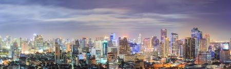 Panorama Aerial view of Bangkok downtown Skyline at night photo