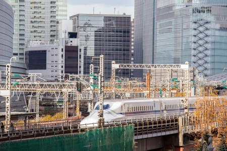 railway with skyline at yurakuchi near ginza Tokyo Japan for transportation background photo
