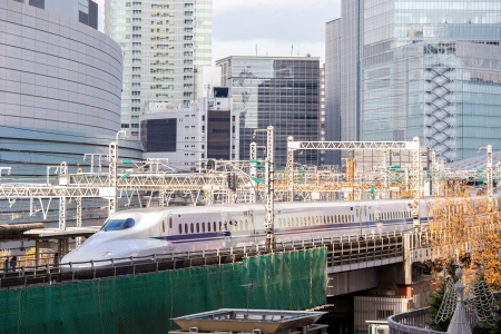 bullet train: railway with skyline at yurakucho near ginza Tokyo Japan for transportation background
