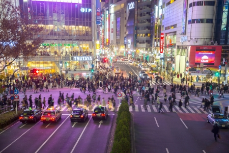implementations: TOKYO - DECEMBER 10: Pedestrians cross at Shibuya Crossing on December 10, 2013 in Tokyo, Japan. The crosswalk is one of the worlds most famous implementations of a scramble crosswalk. Editorial