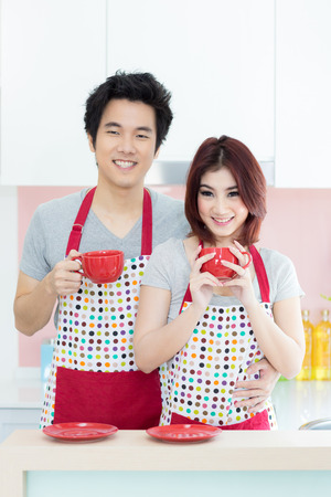 couple with coffee in domestic kitchen photo