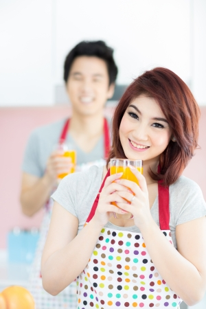Happy Couple with orange juice for breakfast photo