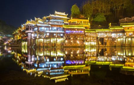 hunan: Fenghuang (Phoenix) ancient town sunset duak, Hunan province, China Stock Photo