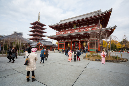 sightseers: TOKYO - DEC 9: Tourists and sightseers wander around Sensoji Temple in the Asakusa district of Tokyo on December 9, 2013. Sensoji is a famous Buddhist Temple in Tokyo , Japan founded in 628.