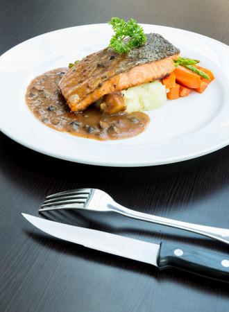 coalfish: grilled salmon steak with pepper sauce Stock Photo