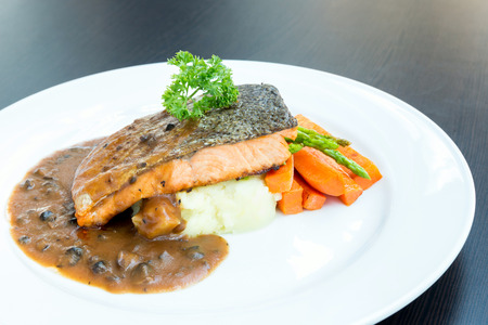 grilled salmon steak with pepper sauce photo
