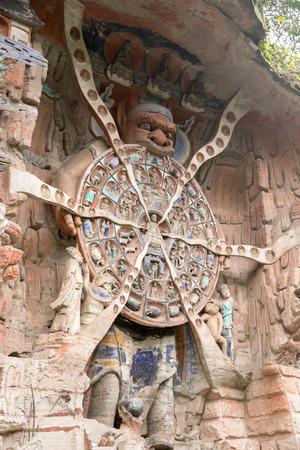 stone carving: Ancient Hillside Stone Carving of Shakyamuni Buddha Repaying His Parents Stock Photo