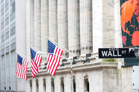 nasdaq: Wall street sign in New York with New York Stock Exchange
