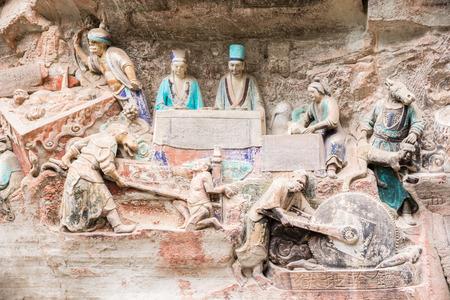 buddhist structures: Ancient Hillside Stone Carving of Shakyamuni Buddha Repaying His Parents Stock Photo