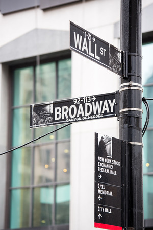 nasdaq: Wall street and broadway sign in New York Editorial