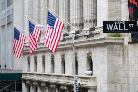 stock: Wall street sign in New York with New York Stock Exchange background