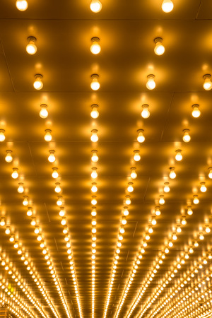 golden bulbs marquee lights background photo