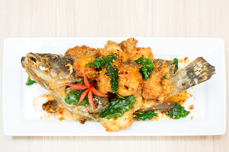deep fried sweet and sour spicy sauce grouper fish photo