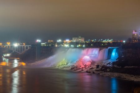 Illumination light of american Falls as viewed from Table Rock in Queen Victoria Park in Niagara Falls at night, Ontario, Canada  photo