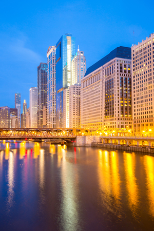 City of Chicago downtown and River with bridges at dusk