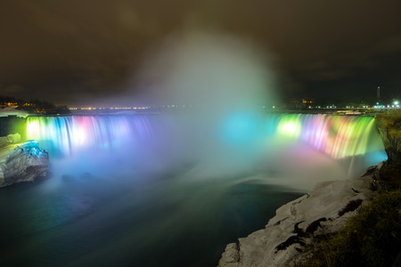 Illumination light of Horseshoe Falls as viewed from Table Rock in Queen Victoria Park in Niagara Falls at night, Ontario, Canada  photo