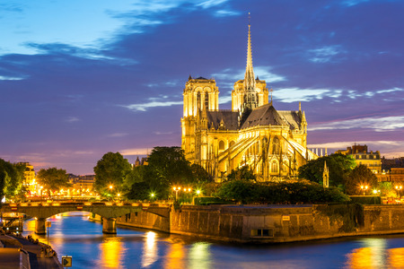 Notre Dame Cathedral at dusk in Paris, France photo