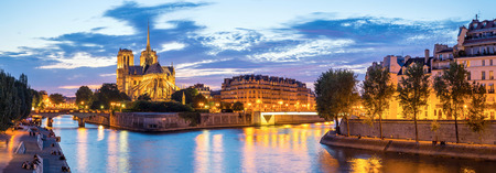 dame: Notre Dame Cathedral with Paris cityscape  panorama at dusk, France