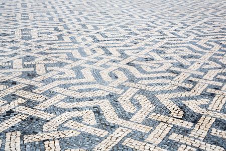 Tile brick floor in Lisbon Town Square, Portugal photo
